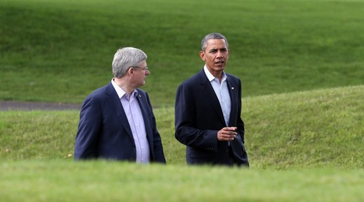 ENNISKILLEN, NORTHERN IRELAND – JUNE 18: US President Barack Obama (R) talks with Canadian Prime Minister Stephen Harper following the 'family' group photograph at the G8 venue of Lough Erne on June 18, 2013 in Enniskillen, Northern Ireland. The two day G8 summit, hosted by UK Prime Minister David Cameron, is being held in Northern Ireland for the first time. Leaders from the G8 nations have gathered to discuss numerous topics with the situation in Syria expected to dominate the talks. (Photo by Matt Cardy/Getty Images)